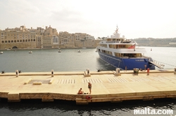 Big yacht in the Vittoriosa Birgu Marina and Senglea in the background