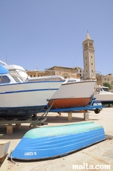Boat yard in front of the Church of St Anne in Marsascala