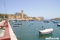 Small Luzzu Marina and St Anne Church in Marsascala