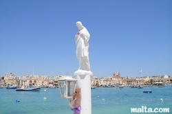 Christian statue at the entrance of Marsaxlokk's harbour