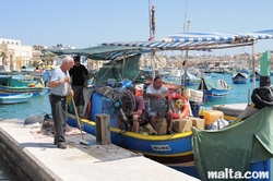 Fishermen in the Marsaxlokk's harbour