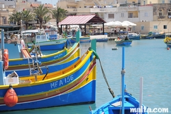 Luzzus onshore in the marsaxlokk harbour