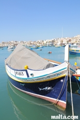 Traditional Luzzu boat in Marsaxlokk