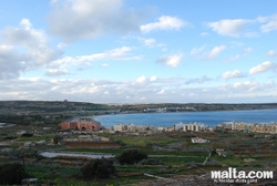 Fields, Mellieha Bay and the Red Tower