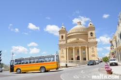 The Parish Church Assumption and a maltese bus
