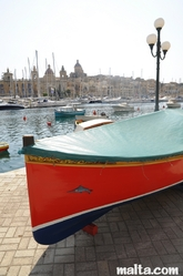 Traditional luzzu boat docked in Senglea