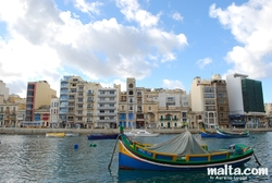 Luzzu and buildings of Spinola Bay