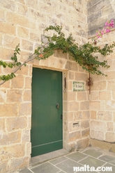 Traditional house door and Bugainvillea in Zurrieq