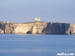 Comino's St. Mary's Tower above the cliff