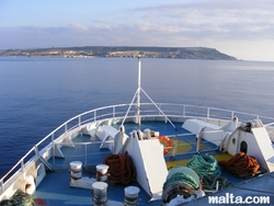 Onboard of the gozo ferry and Malta in the background.JPG