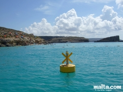 The blue lagoon and Comino from the sea