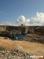 The Santa Maria Watchtower and cliff in Comino