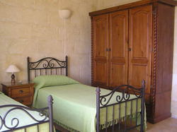 another twin bedroom at ta natu farmhouse gozo
