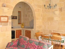 Dining room kitchen living room at ta mananni farmhouse gozo