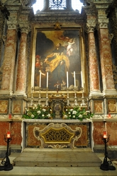 side altar with flowers in St. john's cathedral valletta