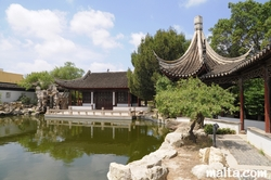 Grand hall, path and lake of the Garden of Serenity in Santa Lucija
