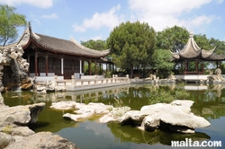 lake and grand hall of the Garden of Serenity in Santa Lucija