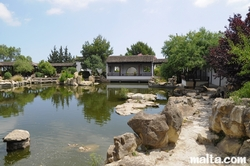Lake, rocks and front temple of the Garden of Serenity in Santa Lucija