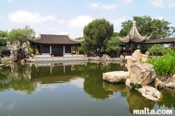 Lake turtles and grand hall of the Garden of Serenity in Santa Lucija