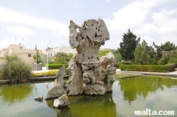 Limestone rock in a fountain of the Garden of Serenity in Santa Lucija