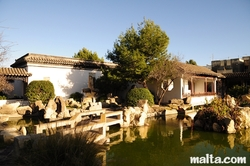 Ornemental Lake and traditionnal constructions in the Garden of Serenity in Santa Lucija