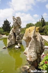 Rocks in a fountain inside the Garden of Serenity in Santa Lucija