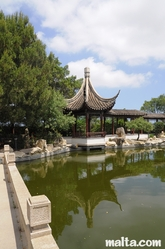 Side small temple and lake of the Garden of Serenity in Santa Lucija