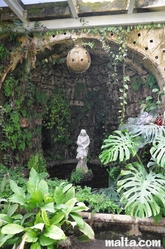 statue in the greenhouse of the palazzo parisio garden