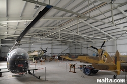 Fighters and helicopter in the Malta Aviation Museum