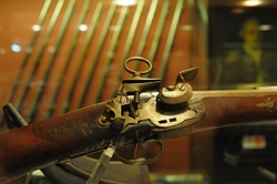 detail of a shotgun in the palace armoury in valletta