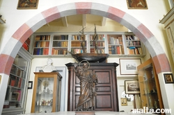 Archives and st Jean Statue in the Archives Room of the Casa Rocca Piccola in valletta