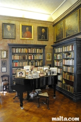 Piano and paintings inside the Library of the Casa Rocca Piccola in valletta