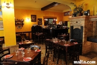 Tables and bar of Ta'Kris Restaurant and Maltese Bistro