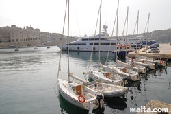 Small sailing boats and Yachts in the Vittoriosa Birgu Marina Senglea in the background.